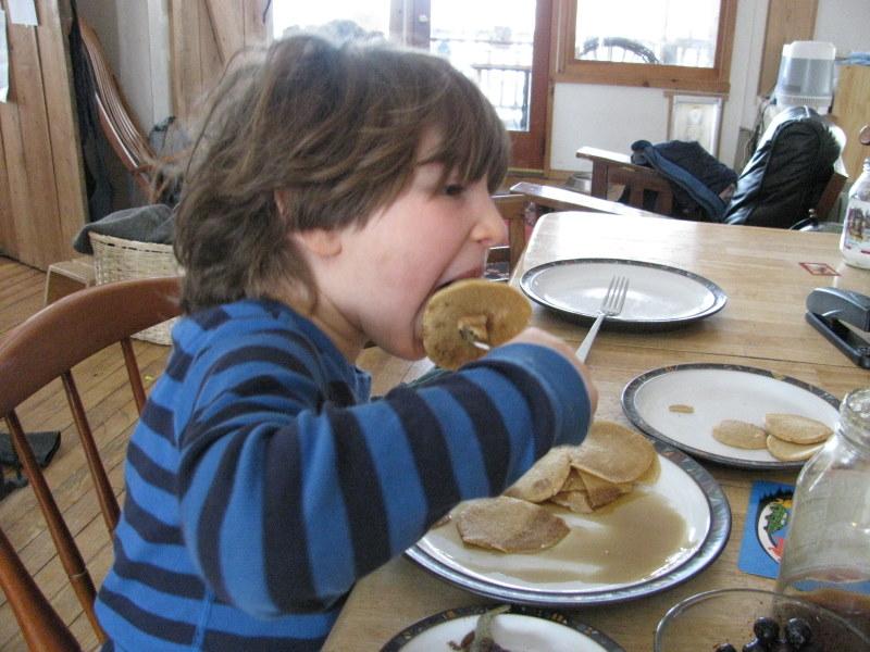 enjoying pancakes